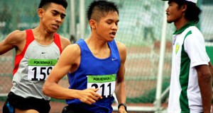Wahyudi Putra peraih 3 emas cabang atletik PON Remaja di Surabaya.