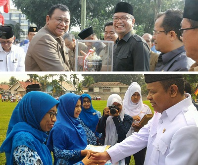 Walikota Payakumbuh H Riza Falepi menerima penghargaan kota pengelolaan pendidikan terbaik Sumbar, Ketua DPRD YB Dt Parmato Alam berikan penghargaan kepada para guru di Payakumbuh.